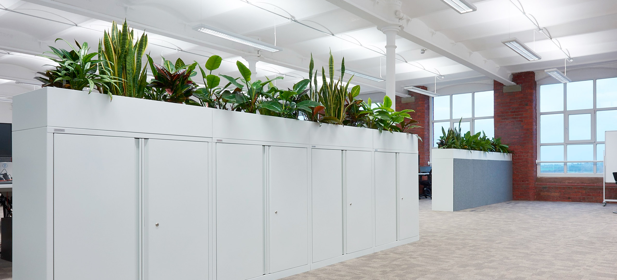 Storage units with integrated plants